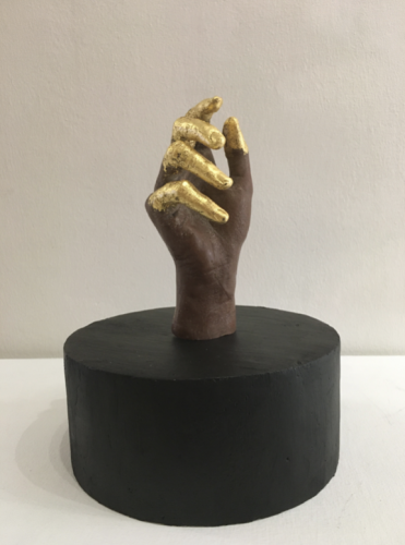 Brown Labour I_2020_Artists' hand-cast in brown wax, 24K gold leaf_Dimensions Variable__As a pair with Brown Labour II